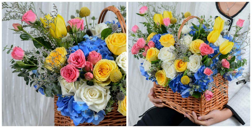 กระเช้าดอกไม้ที่มีกุหลาบหลากสี